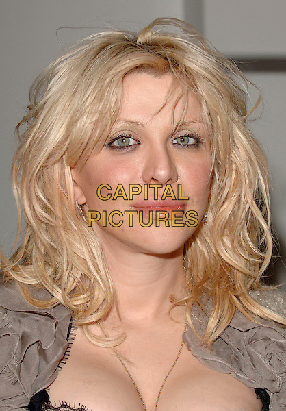 "COURTNEY LOVE.Signs copies of her new tell-all autobiography journal ""Dirty Blonde: The Diaries Of Courtney Love"" at Waterstone's, Piccadilly, London, UK..November 24th,  2006 .headshot portrait book cleavage.CAP/BEL.©Belcher/Capital Pictures"