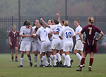 Duke's Lorraine Quinn (third Duke player from left) is mobbed by teammates after she chipped the ball into the goal over a Florida State field player in a goalkeeper's jersey in the 87th minute on Sunday, October 22nd, 2006 at Koskinen Stadium in Durham, North Carolina. The Duke Blue Devils defeated the Florida State University Seminoles 3-1 in an Atlantic Coast Conference NCAA Division I Women's Soccer game.
