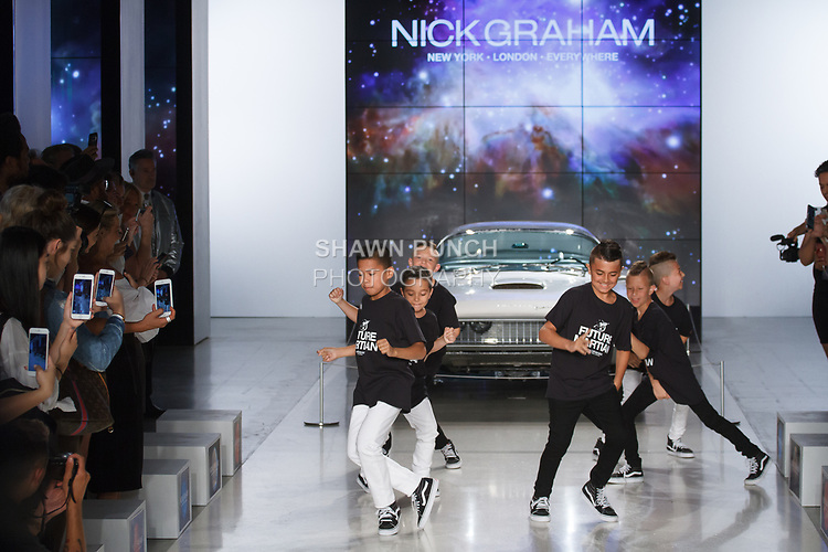 "Icon Dance Complex dancers perform at the close of his Nick Graham Spring Summer 2019 ""1969"" collection fashion show at Cadillac House in New York City on July 10, 2018; during New York Fashion Week: Men's Spring Summer 2019."