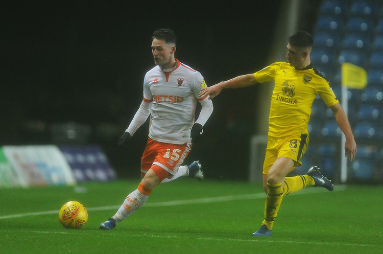 Blackpool's Jordan Thompson under pressure from Oxford United's Cameron Brannagan<br /> <br /> Photographer Kevin Barnes/CameraSport<br /> <br /> The EFL Sky Bet League One - Oxford United v Blackpool - Saturday 15th December 2018 - Kassam Stadium - Oxford<br /> <br /> World Copyright © 2018 CameraSport. All rights reserved. 43 Linden Ave. Countesthorpe. Leicester. England. LE8 5PG - Tel: +44 (0) 116 277 4147 - admin@camerasport.com - www.camerasport.com