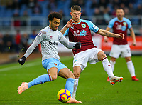 West Ham United's Felipe Anderson clears the ball under pressure from Burnley's Johann Gudmundsson<br /> <br /> Photographer Alex Dodd/CameraSport<br /> <br /> The Premier League - Burnley v West Ham United - Sunday 30th December 2018 - Turf Moor - Burnley<br /> <br /> World Copyright © 2018 CameraSport. All rights reserved. 43 Linden Ave. Countesthorpe. Leicester. England. LE8 5PG - Tel: +44 (0) 116 277 4147 - admin@camerasport.com - www.camerasport.com