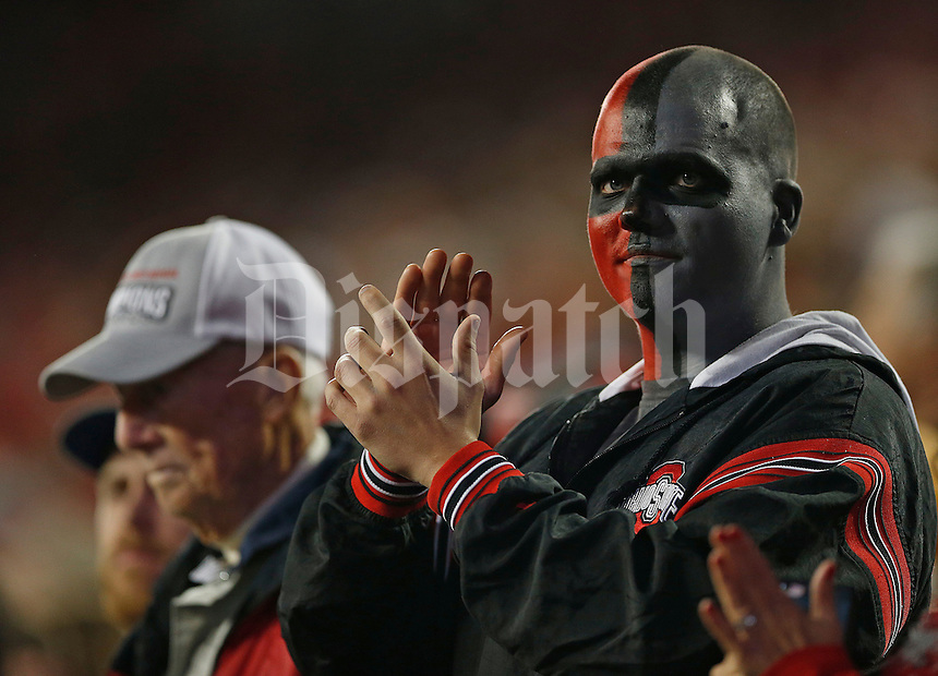 Ohio State fan before the NCAA football game between the Ohio State Buckeyes and the Nebraska Cornhuskers at Ohio Stadium in Columbus on Saturday, November 5, 2016. (Columbus Dispatch photo by Jonathan Quilter)