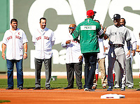 Derek Jeter #2 of the New York Yankees is greeted by former Boston Celtics player, Paul Pierce, during pregame ceremonies at Fenway Park in Jeter's final career game on September 27, 2014 in Boston, Massachusetts. (Photo by Jared Wickerham for the New York Daily News)