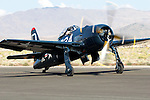 Ray Diekman taxies a Grumman built F8F Bearcat along the ramp at Stead Field in Nevada. The Bearcat was designed as an interceptor with a high rate of climb to counter the Japanese kamikaze threat. The first Bearcat squadron became operational in May of 1945 but World War II ended before the aircraft saw combat service. It was largely replaced as a front line fighter with the arrival of jets prior to the beginning of the Korean War. Their were 1,126 Bearcats produced of which approximately 11 airworthy examples remain. Photographed 09/07