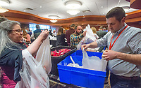 NWA Democrat-Gazette/BEN GOFF @NWABENGOFF<br /> Charlotte Martin (left) of Springdale and Jason Martzke of Winfield, Ill. work with other Tyson employees to fill snack packs Wednesday, Dec. 5, 2018, at Embassy Suites Northwest Arkansas in Rogers. More than 800 Tyson employees from across the country who are in town this week attending the company's annual sales conference took the afternoon to pack and load food donations. The employees helped distribute 35,000 pounds of Tyson products to Northwest Arkansas organizations with feeding services and food banks. In addition 1,000 meal boxes, 15,000 snack packs and personal hygiene kits were packaged and distributed to Northwest Arkansas non-proffits.