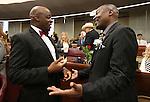 Nevada Sen. Kelvin Atkinson, left, and Assemblyman Tyrone Thompson, both D-North Las Vegas, talk before opening day ceremonies at the Legislative Building in Carson City, Nev., on Monday, Feb. 2, 2015. (Cathleen Allison/Las Vegas Review-Journal)