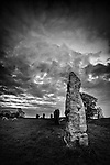 Ancient standing stones under a stormy sky