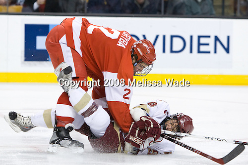 Eric Gryba (BU 2) hits Nate Gerbe (BC 9). The Boston College Eagles defeated the Boston University Terriers 4-3 in overtime in their first Monday Beanpot matchup on February 4, 2008 at the TD Banknorth Garden in Boston, Massachusetts.