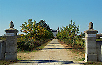The entrance to the chateau grounds: the two gate posts with a small gravel road leading up to the chateau  Caillou, Grand Cru Classe, Barsac, Sauternes, Bordeaux, Aquitaine, Gironde, France, Europe