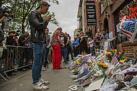 NEW YORK JUNE 13: A man prays outside of the Stonewall Inn in Manhattan. Thousands of mourners gathered for a vigil by the Stonewall Inn, a historic New York City gay bar, to pay tribute to the victims of the massive shooting in a gay nightclub in Orlando, Florida. New York City June 13, 2016<br /> Photo by VIEWpress/Maite H. Mateo.