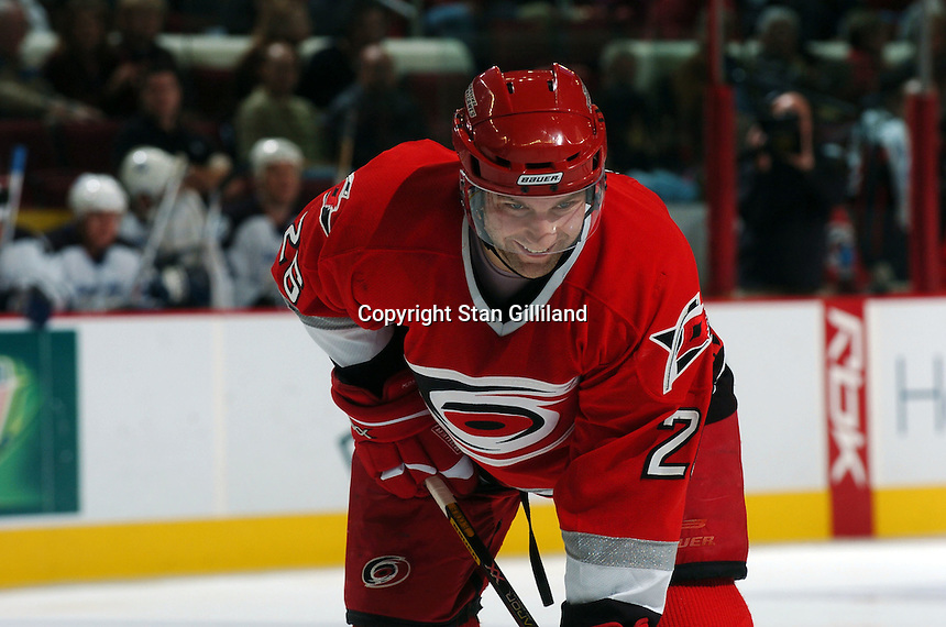 Carolina Hurricanes' Erik Cole finds some amusement in things prior to a faceoff during a game with the Tampa Bay Lightning Sunday, Nov. 20, 2005 in Raleigh, NC.  Tampa Bay won 5-2.