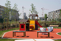 milano, nuovo quartiere rogoredo - santa giulia, periferia sud-est. il campo giochi di un asilo nido --- milan, new district rogoredo - santa giulia, south-east periphery. a play ground at a day nursery