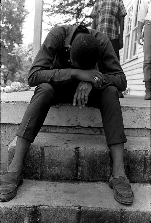 Young man of Newtown area of Montgomery, Ala, sitting on steps of a neighborhood store. From an essay photographed by Jim Peppler for The Southern Courier in August, 1967. Copyright Jim Peppler/1967. This and over 10,000 other images are part of the Jim Peppler Collection at The Alabama Department of Archives and History:  http://digital.archives.alabama.gov/cdm4/peppler.php