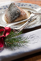 Roasted sturgeon served with potato cream flavoured with caviar and a monogrammed napkin decorated with spruce