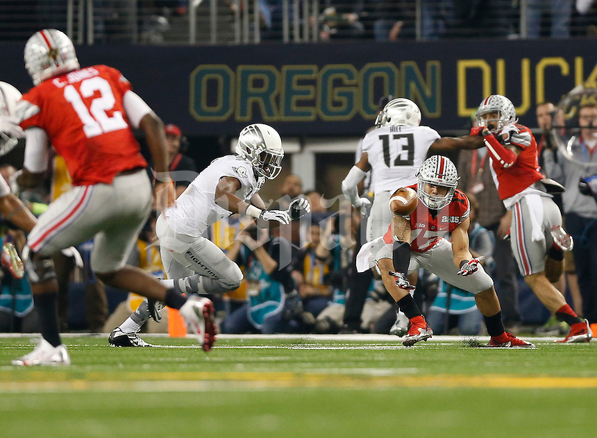 Ohio State Buckeyes running back Jalin Marshall (17) hauls in a pass from Ohio State Buckeyes quarterback Cardale Jones (12) in the third quarter of the College Football Playoff National Championship between the Ohio State Buckeyes and the Oregon Ducks at AT&T Stadium in Arlington, Texas, Monday afternoon, January 12, 2015. The Ohio State Buckeyes defeated the Oregon Ducks 42 - 20. (The Columbus Dispatch / Eamon Queeney)