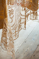 Detail of an ornamental French lace tablecloth