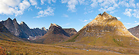Campsite on the autumn tundra with a view of East and West Maiden, Camel, Parabala and Elephants tooth peaks, Arrigetch Peaks, Gates of the Arctic National Park, Alaska.