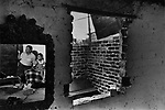 "Family in their abandoned building home in a large (2.5 Million resident) squatter settlement called ""Neza"" (Nezahualcoyotl) in Mexico City (Sept. 19) in September, 1985. This is days after an Earthquake did major damage to downtown Mexico City. Photo by Jim Peppler. Copyright/Jim Peppler/."