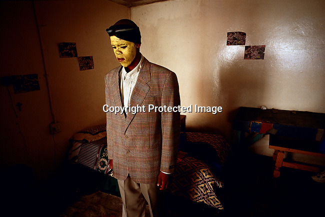 Luxolo Mkwelo, age 19, stands in his room after coming home from a traditional manhood ceremony in Tshatshu, South Africa. He spent six weeks in the bush learning to be a man. He was circumcised and elders guided him during the ceremony, which is to prepare them for adulthood. Former South African president Nelson Mandela went trough the ceremony when he was young. (Photo by: Per-Anders Pettersson)