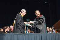 Gregory Tollisen, Adjunct Assistant Professor, Mathematics receives the Linda and Tod White Teaching Prize from Jorge Gonzalez. Incoming first-years start the year at Occidental College's 127th annual Convocation ceremony on Aug. 28, 2013 in Thorne Hall.<br /> (Photo by Marc Campos, Occidental College Photographer)