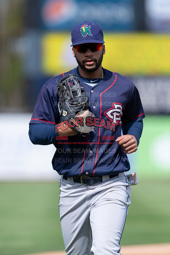 Cedar Rapids Kernels center fielder Gilberto Celestino (8) jogs off the field between innings of a Midwest League game against the Kane County Cougars at Northwestern Medicine Field on April 28, 2019 in Geneva, Illinois. Kane County defeated Cedar Rapids 3-2 in game one of a doubleheader. (Zachary Lucy/Four Seam Images)