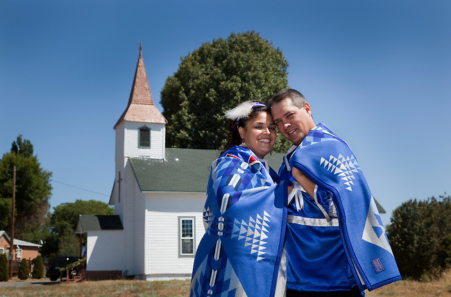 Newly wed couple at the Williamson River Indian Mission church are wrapped together inside an Indian blanket as a symbol of a long and happy marriage.