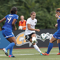 Portland Thorns FC forward Alex Morgan (13) passes the ball.  In a National Women's Soccer League (NWSL) match, Portland Thorns FC (white/black) defeated Boston Breakers (blue), 2-1, at Dilboy Stadium on July 21, 2013.