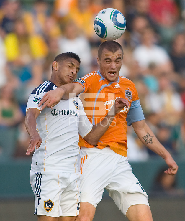 LA Galaxy defender Sean Franklin (28) battles Houston Dynamo forward Cam Weaver (15) for a ball. The LA Galaxy defeated the Houston Dynamo 4-1 at Home Depot Center stadium in Carson, California on Saturday evening June 5, 2010..