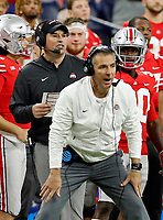 Ohio State Buckeyes head coach Urban Meyer coaches while Ohio State Buckeyes offensive coach Ryan Day calls a play against Northwestern Wildcats during the Big Ten Championship game in Indianapolis, Ind on December 1, 2018.  [Kyle Robertson/Dispatch]