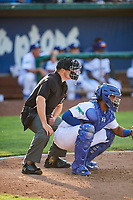 Hendrik Clementina (31) of the Ogden Raptors and home plate umpire Colin Baron during the against the Orem Owlz in Pioneer League action at Lindquist Field on June 21, 2017 in Ogden, Utah. The Owlz defeated the Raptors 16-5. This was Opening Night at home for the Raptors.  (Stephen Smith/Four Seam Images)