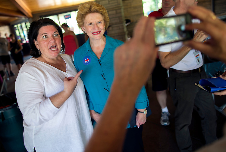 UNITED STATES - August 16: Sen. Debbie Stabenow, D-Mich., has her photograph taken with a former congressional staffer of Former U.S. Sen. Tom Harkin, at the Scott County Democrats Picnic in the Park in Eldridge, Iowa, on Sunday, August 16, 2015. (Photo By Al Drago/CQ Roll Call)