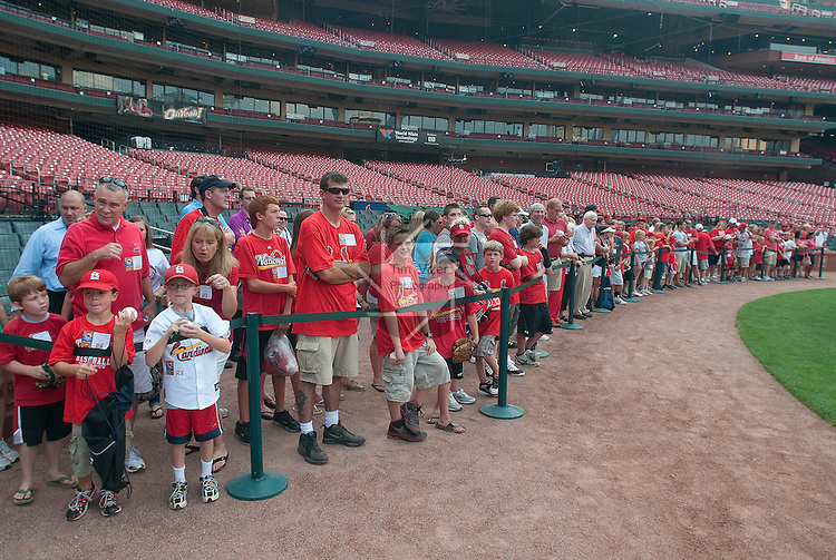 06 July 2011              Fans line up on the field to watch pre-game workouts and batting practice, first by the Cardinals, then by the Reds.  The St. Louis Cardinals hosted the Cincinnati Reds in the final game of a three-game series on Wednesday July 6, 2011 at Busch Stadium in downtown St. Louis.