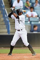 Tampa Yankees third baseman Jose Rosario (12) at bat during a game against the Dunedin Blue Jays on June 28, 2014 at George M. Steinbrenner Field in Tampa, Florida.  Tampa defeated Dunedin 5-2.  (Mike Janes/Four Seam Images)