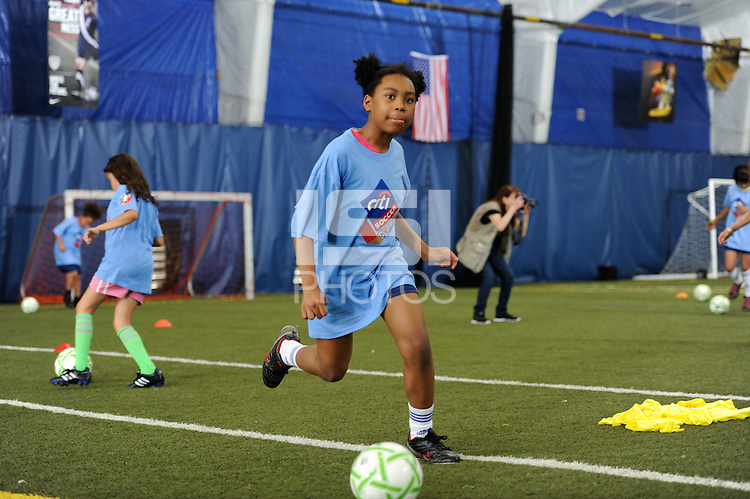 Students participate during a Women's Professional Soccer (WPS) soccer clinic at the Starfinder Foundation Facility in Philadelphia, PA, on May 24, 2011.