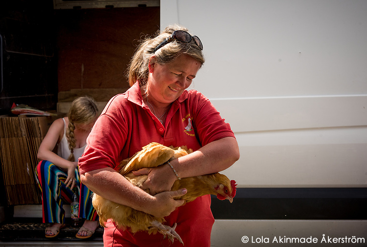 A local farmer shows off her chickens