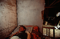 QSFeature02AIDS008 20020212 DONGGUAN, CHINA:  .27 yr old AIDS paitient Ding Hongjun lays in his death bed in Dongguan Village, Henan Province, China 12 February 2002. Like Ding, over 700,000 peasant farmers have contracted the HIV virus when they participated in the unregulated blood selling/buying boom of the early and mid nineties. Ding died shortly after this photo was taken..Photo by: Qilai Shen...
