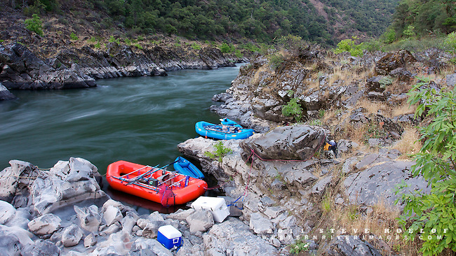 The boats in their repective rock bays. This site is one tough gear haul up the rocks.