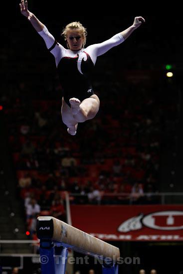 Trent Nelson  |  The Salt Lake Tribune.Salt Lake City - Utah's Courtni Beers on the beam, Utah vs. BYU college gymnastics Friday, March 26, 2010.