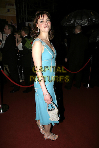 KATE FORD.At the After Party for the Pioneer British Academy Television Awards (TV BAFTA's), Grosvenor House Hotel, .London, April 17th 2005..full length blue dress funny face .Ref: AH.www.capitalpictures.com.sales@capitalpictures.com.©Adam Houghton/Capital Pictures.