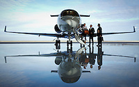Hawker 900 XP corporate Jet with business passengers boarding.