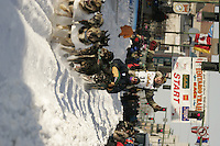 March 3, 2007   4-time champion Jeff King runs down 4th avenue during the Iditarod ceremonial start day in Anchorage