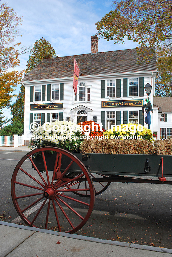 Essex Village, Connecticut, USA, main street, Griswold Inn, Goods & Curiosities, cart, flowers, straw bale, 201110185301..Copyright Image from Victor Patterson, 54 Dorchester Park, Belfast, United Kingdom, UK...For my Terms and Conditions of Use go to http://www.victorpatterson.com/Victor_Patterson/Terms_%26_Conditions.html