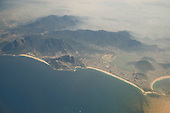 Rio de Janeiro, Brazil. Aerial view of Copacabana, Ipanema, Leblon and Sao Conrado beaches, the Lagoa Rodrigo de Freitas lagoon and the hills behind.