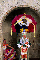 Colorful historical man dancer in traditional head dress in Oaxaca Mexico.