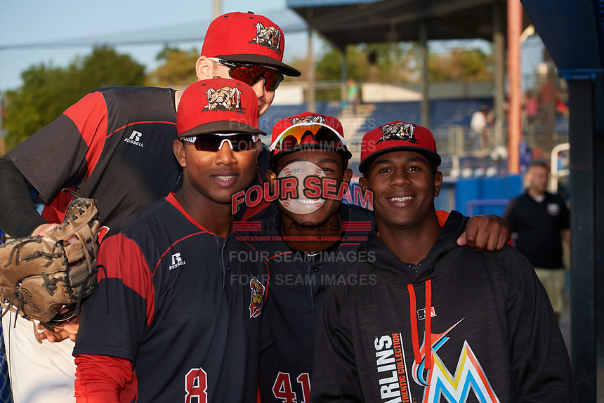 Batavia Muckdogs Samuel Castro (left), Brayan Hernandez (center), Marcos Rivera (right), and Sean Reynolds (back) in the dugout before a game against the Auburn Doubledays on August 26, 2017 at Dwyer Stadium in Batavia, New York.  Batavia defeated Auburn 5-4.  (Mike Janes/Four Seam Images)