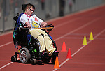 Tina Harris, of Carson City, competes in the wheelchair obstacle course during the Special Olympics Nevada 2013 Summer Games in Reno, Nev., on Saturday, June 1, 2013. <br /> Photo by Cathleen Allison