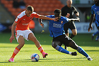 Blackpool's Jerry Yates under pressure from Swindon Town's Anthony Grant<br /> <br /> Photographer Kevin Barnes/CameraSport<br /> <br /> The EFL Sky Bet League One - Blackpool v Swindon Town - Saturday 19th September 2020 - Bloomfield Road - Blackpool<br /> <br /> World Copyright © 2020 CameraSport. All rights reserved. 43 Linden Ave. Countesthorpe. Leicester. England. LE8 5PG - Tel: +44 (0) 116 277 4147 - admin@camerasport.com - www.camerasport.com