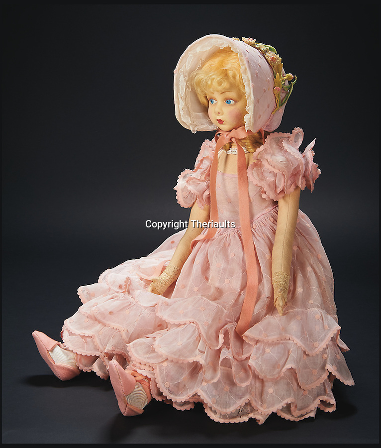 BNPS.co.uk (01202 558833)<br /> Pic: Theriaults/BNPS<br /> <br /> Shirley Temple's legendary Italian felt salon doll known as 'Pinkie'.<br /> <br /> The costumes worn by childhood movie star Shirley Temple during her Hollywood career make up a long-lost £1.5m collection belonging to the late actress.<br /> <br /> The curly-haired performer's parents made it a condition that she got to keep all of her outfits after filming rather than return them to the movie studios.<br /> <br /> The child costumes, that include the iconic red and white polka-dot dress the then six year old wore in her breakthrough role in the 1934 flick 'Stand Up and Cheer', have been locked away in a vault at her home for 75 years. They are being sold in Maryland, US.