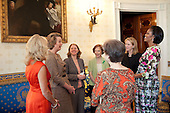 First Lady Michelle Obama and Dr. Jill Biden, talk with, from left, Anne Eisenhower, Former First Lady Rosalynne Carter, granddaughter Sara Carter, Susan Eisenhower, and Kathleen Biden's mother, Roberta Buhle, in the Blue Room of the White House, before the start of a Mother's Day Tea, Friday, May 7, 2010. .Mandatory Credit: Samantha Appleton - White House via CNP