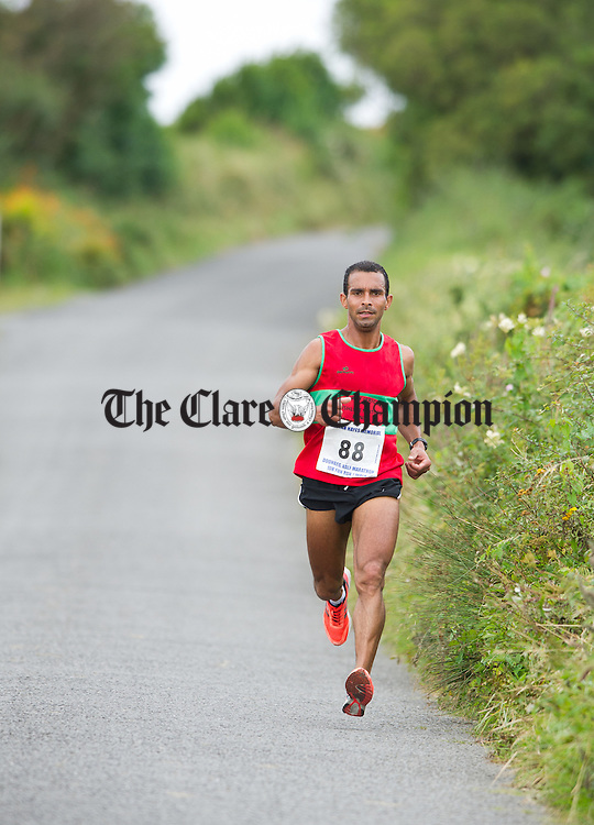 Julius Ceaser on his way to taking second place during the Declan Hayes Memorial Doonbeg Half Marathon/10K Fun Run and Walk. Photograph by John Kelly.